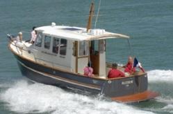 Rhéa 800 passar både som fritids- och fiskebåt.